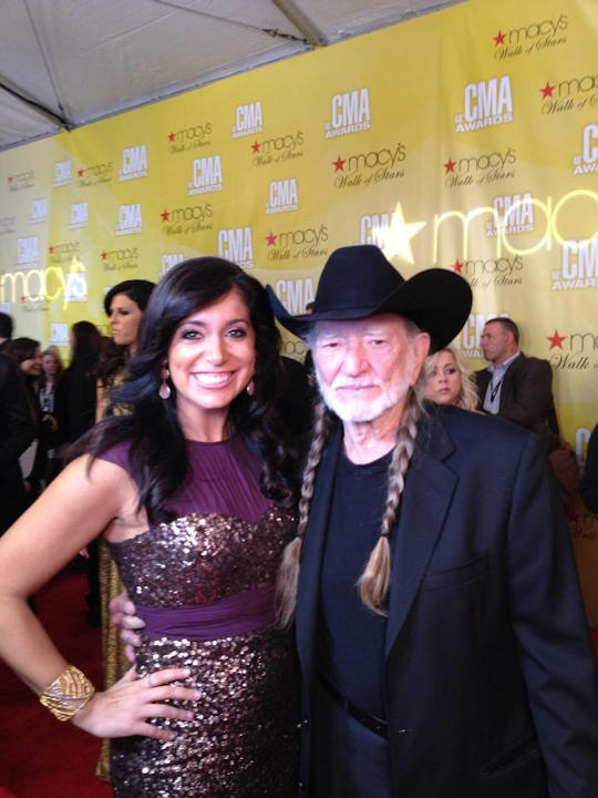 Alicia Vitarelli with Willie Nelson on the red carpet of the Country Music Awards in Nashville on November 1, 2012.