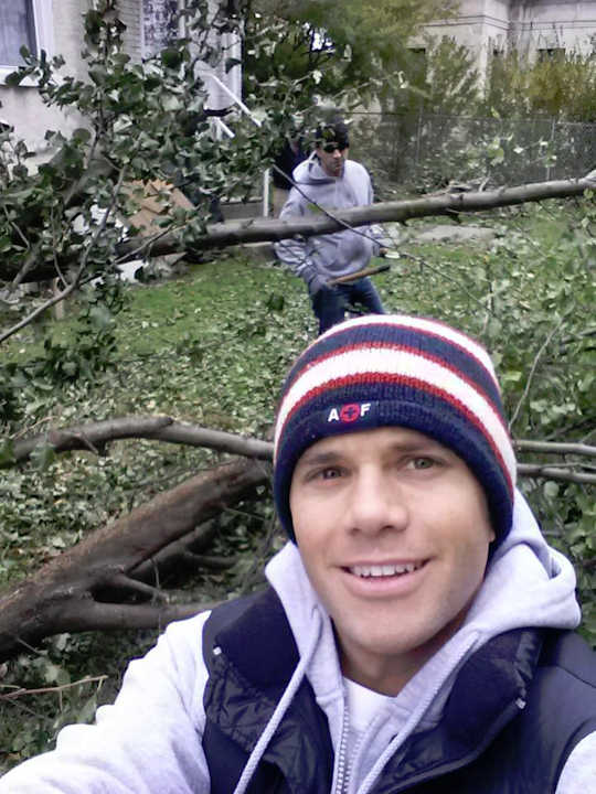 "<div class=""meta image-caption""><div class=""origin-logo origin-image ""><span></span></div><span class=""caption-text"">Adam Joseph removes a tree that fell in his neighbor's backyard during Hurricane Sandy.</span></div>"