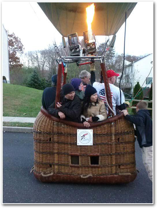 A group of 6 people had to make a quick landing in their hot air balloon on a front lawn in Douglassville, Berks County on November 4, 2013.    An Action News viewer sent in these photos.