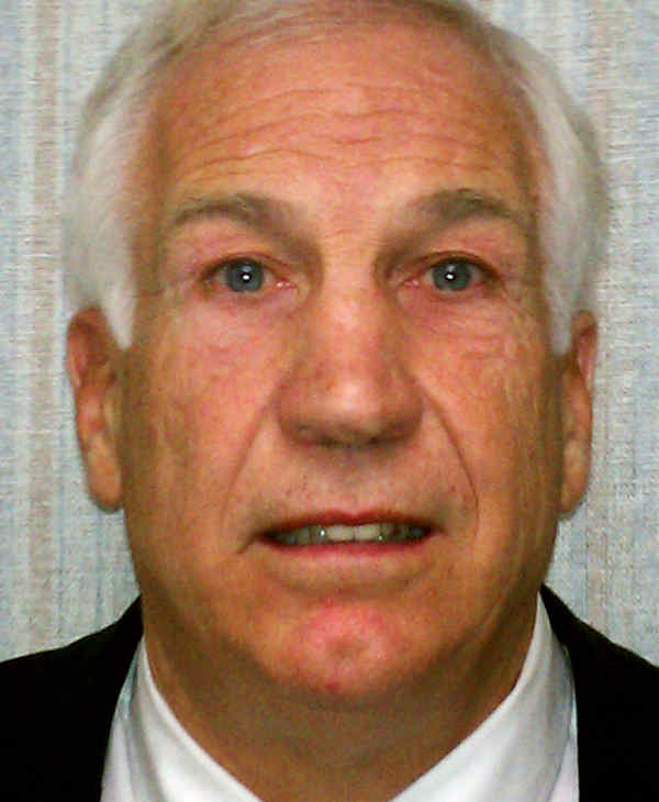 "This Saturday, Nov. 5, 2011 photo provided by the Pennsylvania Office of Attorney General shows former Penn State football defensive coordinator Gerald ""Jerry"" Sandusky. Sandusky is charged with sexually abusing eight young men. Also, Penn State athletic director Tim Curley and Penn State vice president for finance and business Gary Schultz, 62, are expected to turn themselves in on Monday in Harrisburg, Pa., on charges of perjury and failure to report under Pennsylvania?s child protective services law in connection with the investigation into the abuse allegations against Sandusky. (AP Photo/Pennsylvania Office of Attorney General)"