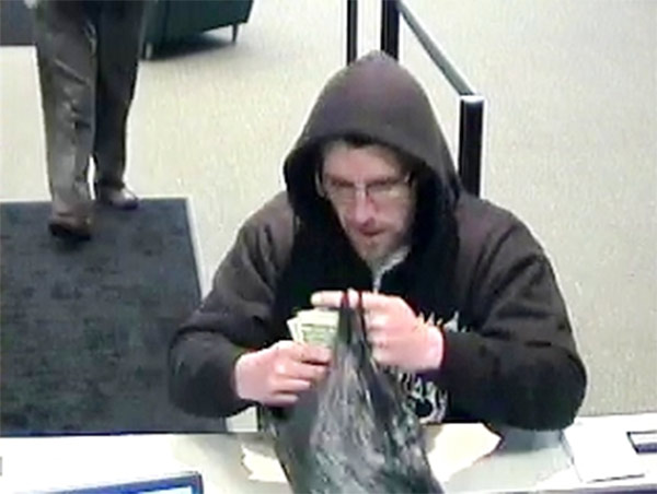 "Local and federal authorities are asking for the public's help in their search for a man suspected of robbing two banks in Philadelphia's Mayfair section. The subject is described as a white male in his mid-30s, approximately 5'8"" tall, thin to medium build, with facial hair. During the Citizens Bank robbery he wore a black and white Billabong hooded sweatshirt, dark colored pants, sneakers, and eyeglasses. For the robbery at the Republic Bank, he was wearing a gray hooded sweatshirt with the words ""Lynchburg Lacrosse"" in red text on the chest.  If you know who this man is or where he may be you are urged to contact authorities. To submit a tip via telephone, dial 215-686-8477 or text a tip to PPD TIP or 773847. You can also contact the FBI/PPD Violent Crimes Task Force at 215-418-4000."