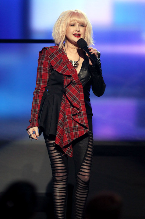 Cyndi Lauper introduces Ke$ha at the 40th Annual American Music Awards on Sunday, Nov. 18, 2012, in Los Angeles. (Photo by Matt Sayles/Invision/AP)