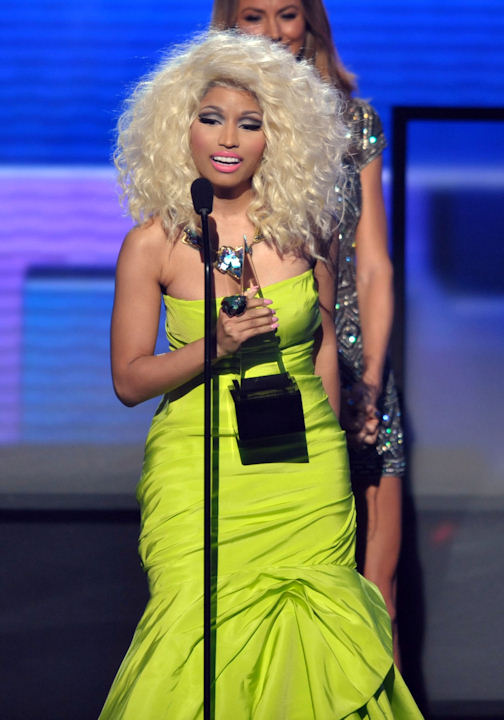 "<div class=""meta ""><span class=""caption-text "">Nicki Minaj accepts the award for favorite album - rap/hip-hop ""Pink Friday: Roman Reloaded"" at the 40th Annual American Music Awards on Sunday, Nov. 18, 2012, in Los Angeles. (Photo by John Shearer/Invision/AP) </span></div>"