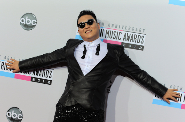"<div class=""meta image-caption""><div class=""origin-logo origin-image ""><span></span></div><span class=""caption-text"">PSY arrives at the 40th Anniversary American Music Awards on Sunday, Nov. 18, 2012, in Los Angeles. (Photo by Jordan Strauss/Invision/AP) </span></div>"
