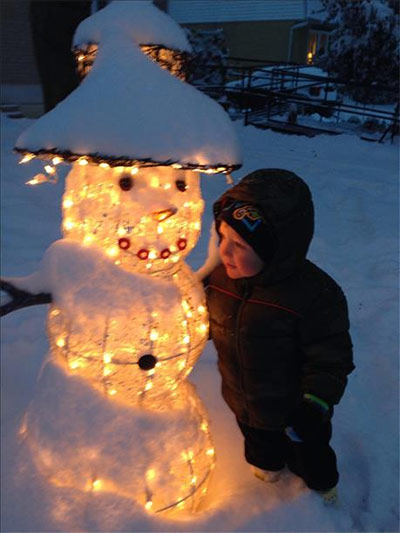 Little Ethan was out and about enjoying the weather with Mr. Snowman!