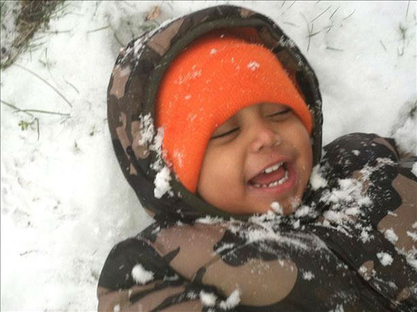 Shoshon is laughing it up while playing in the snow! (submitted photo)