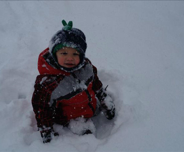 Jacob is clearly enjoying his first snow day! (submitted photo)
