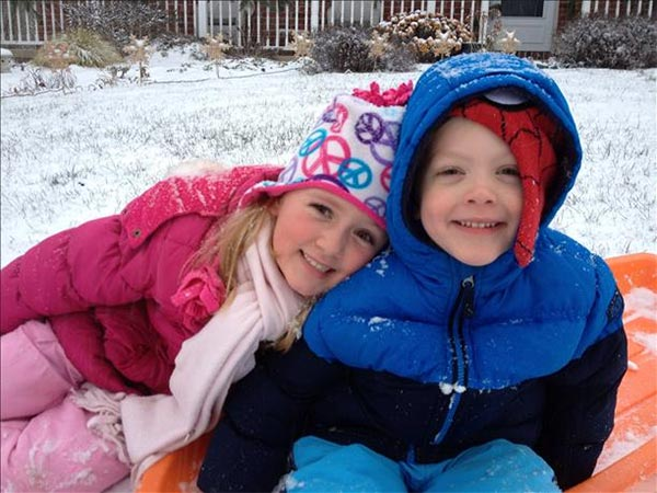Madelyn and Ethan enjoying the snow on their day off from school