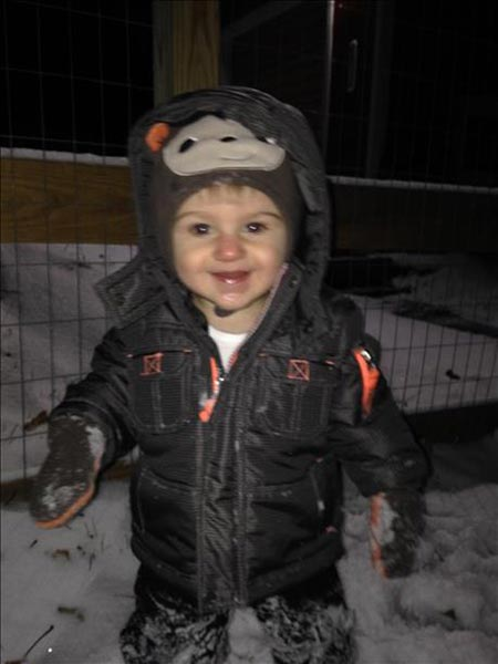 Liam is all smiles for his first snow!