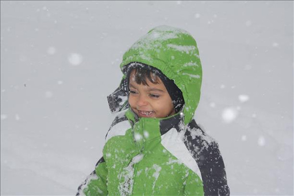 "<div class=""meta ""><span class=""caption-text "">Elijah is loving this snowy weather!!</span></div>"