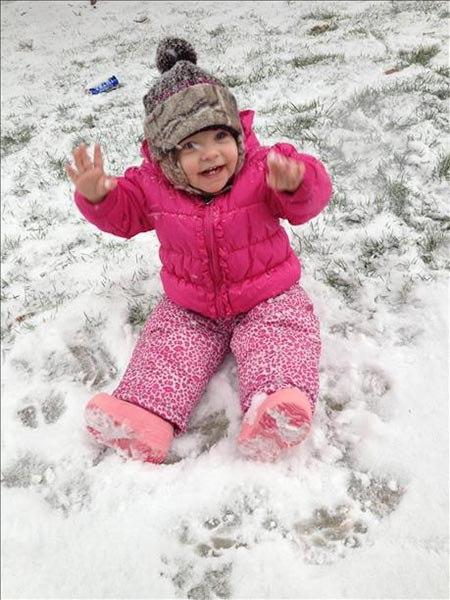 Emma loving her 1st time in the snow!!