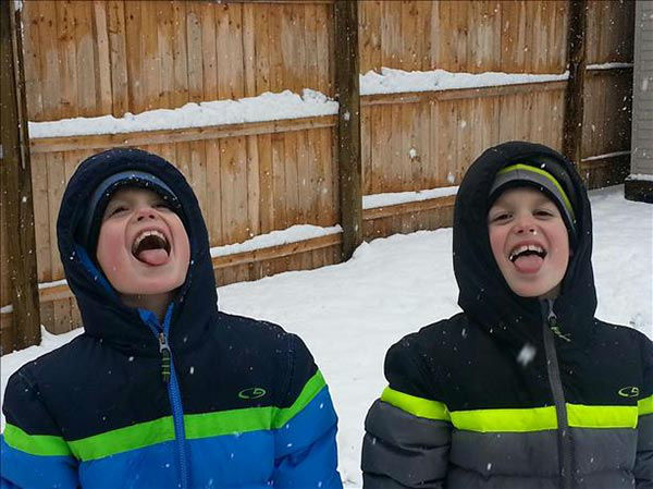 Nine year old twins Matthew and Brendan Marano enjoy catching the snow...on their tongues!