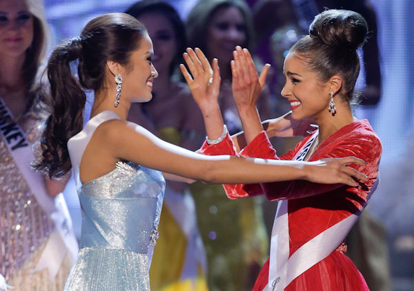 Miss USA, Olivia Culpo, right, reacts and hugs first runner-up, Miss Philippines, Janine Tugonon, after being crowned Miss Universe during the Miss Universe competition, Wednesday, Dec. 19, 2012, in Las Vegas. (AP Photo/Julie Jacobson)