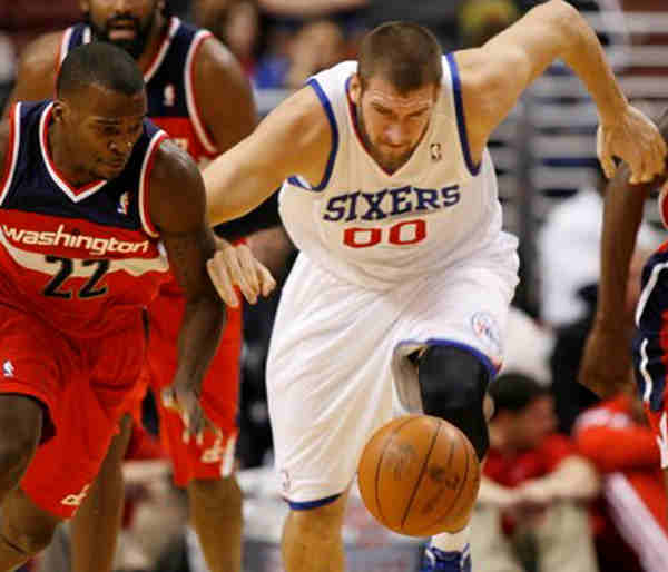 Washington Wizards&#39; Shelvin Mack &#40;22&#41; and Philadelphia 76ers&#39; Spencer Hawes &#40;00&#41; chase a loose ball in the first half of a preseason NBA basketball game Tuesday, Dec. 20, 2011, in Philadelphia.  <span class=meta>( &#40;AP Photo&#47;H. Rumph Jr &#41;)</span>