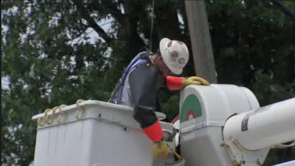 Storm cleanup continues as power outages wane