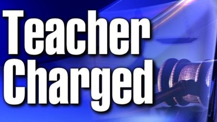 Teacher Charged