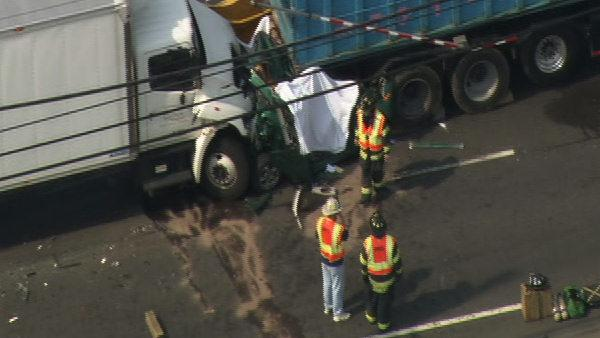 Car crushed between trucks in Camde