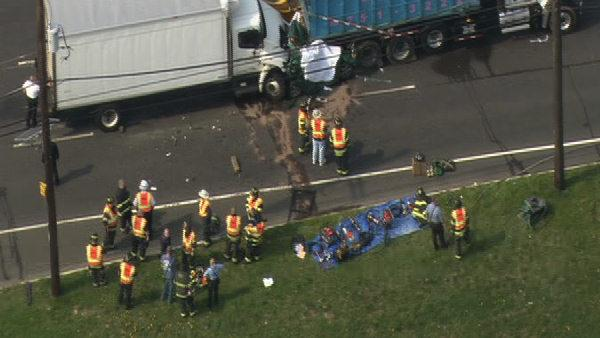 Car crushed between trucks in Camden County