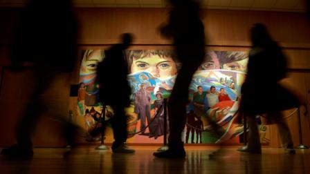 Students walk past The Apotheosis of Youth, a mural by Eliseo Art Silva at the Milton Hershey School in Hershey, Pa., Tuesday, Feb. 13, 2007. The Milton Hershey School plans to enroll 500 new students next fall. (AP Photo/Carolyn Kaster)