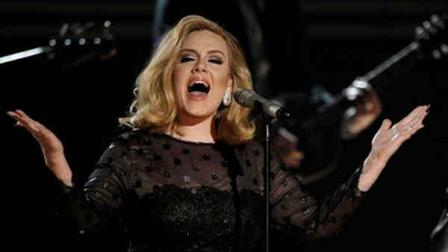 Adele performs during the 54th annual Grammy Awards on Sunday, Feb. 12, 2012 in Los Angeles. (AP Photo/Matt Sayles)