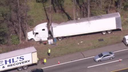 Tractor-trailer veers off New Jersey Turnpike in crash