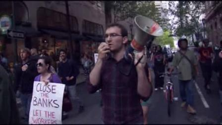 More than 100 Occupy Philadelphia protesters joined the worldwide May Day demonstrations by marching and rallying outside a downtown bank on May 1, 2012.