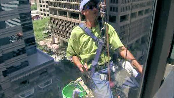 Window washers battle the heat