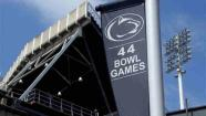 A banner celebrating the 44 bowl games that the Penn State football team has played in hangs outside of Beaver Stadium on the Penn State University main campus in State College, Pa., Monday, July 23, 2012. (AP Photo/Gene J. Puskar)