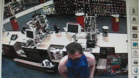 Surveillance photos of suspect wanted in CVS robbery