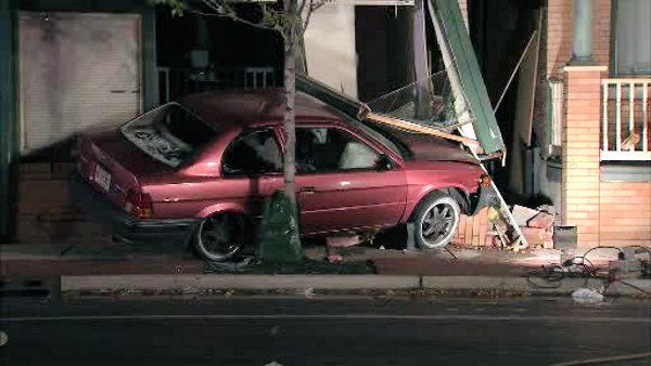 Car slams into Camden home, trapping woman