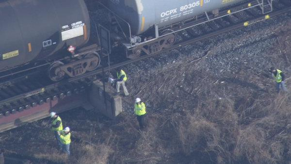 Train carrying chemicals derails into Del. River