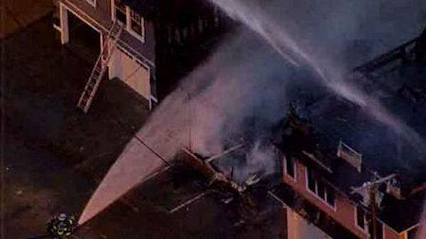 Homes burn near Sandy-damaged oceanfront