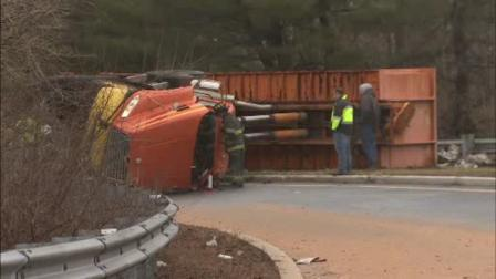 Rig carrying scrap metal overturns in Lawrence Twp.