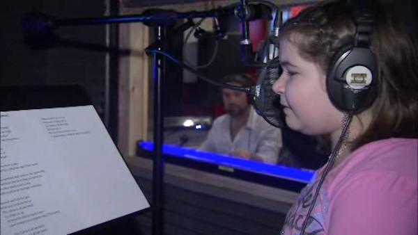 Young girl battling brain tumor earns record contract