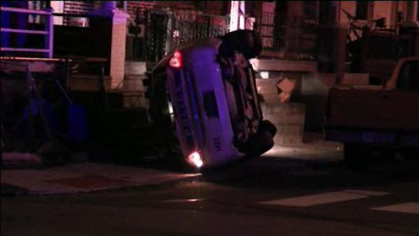 Police car rolls over in East Mt. Airy