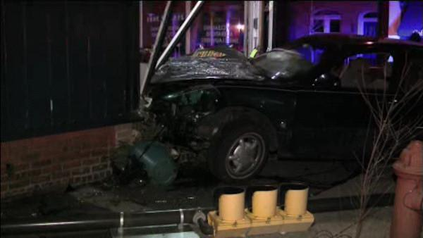 Crash damages Center City dry cleaners, driver flees