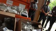 May 23, 2013: Pennsylvania State troopers stand near drugs, cash seized in a Montgomery County drug bust.