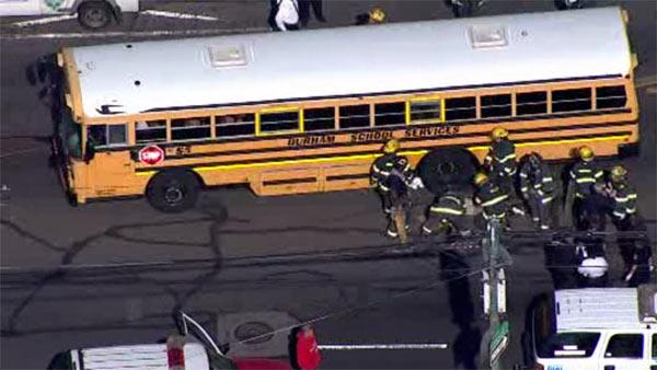 Woman struck, killed by school bus in Mayfair