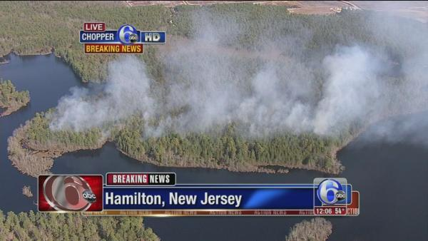 Forest fire burns in Hamilton, NJ