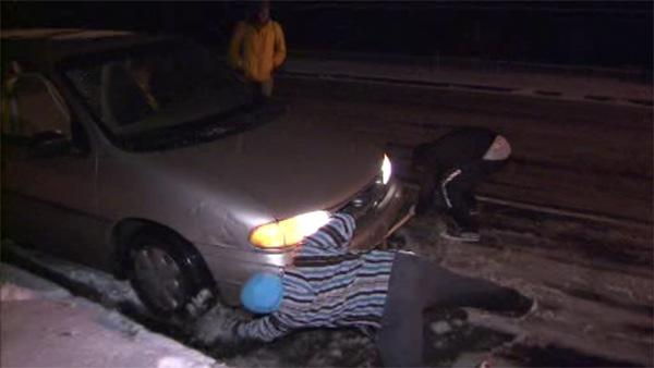 Phila. students dig out cars stuck in slush