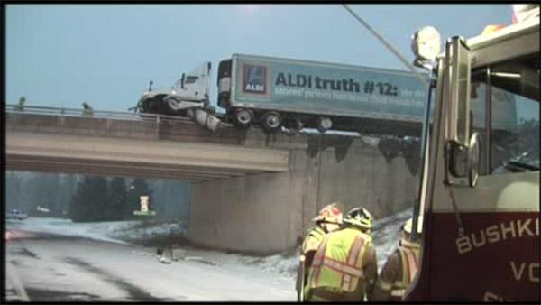 Truck hangs off overpass in Bushkill Twp.