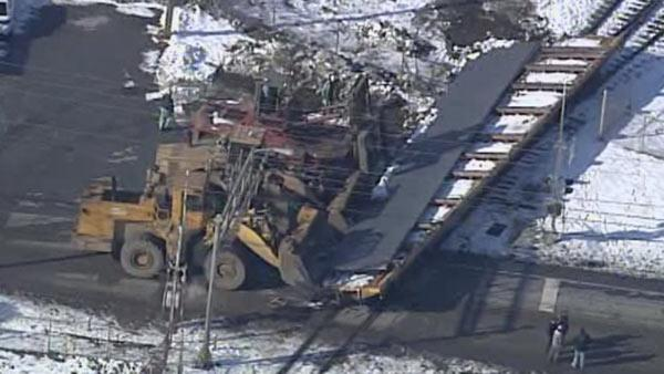 Derailed train car blocks road in Coatesville