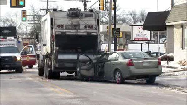 Trash truck, car collide in Media; serious injuries