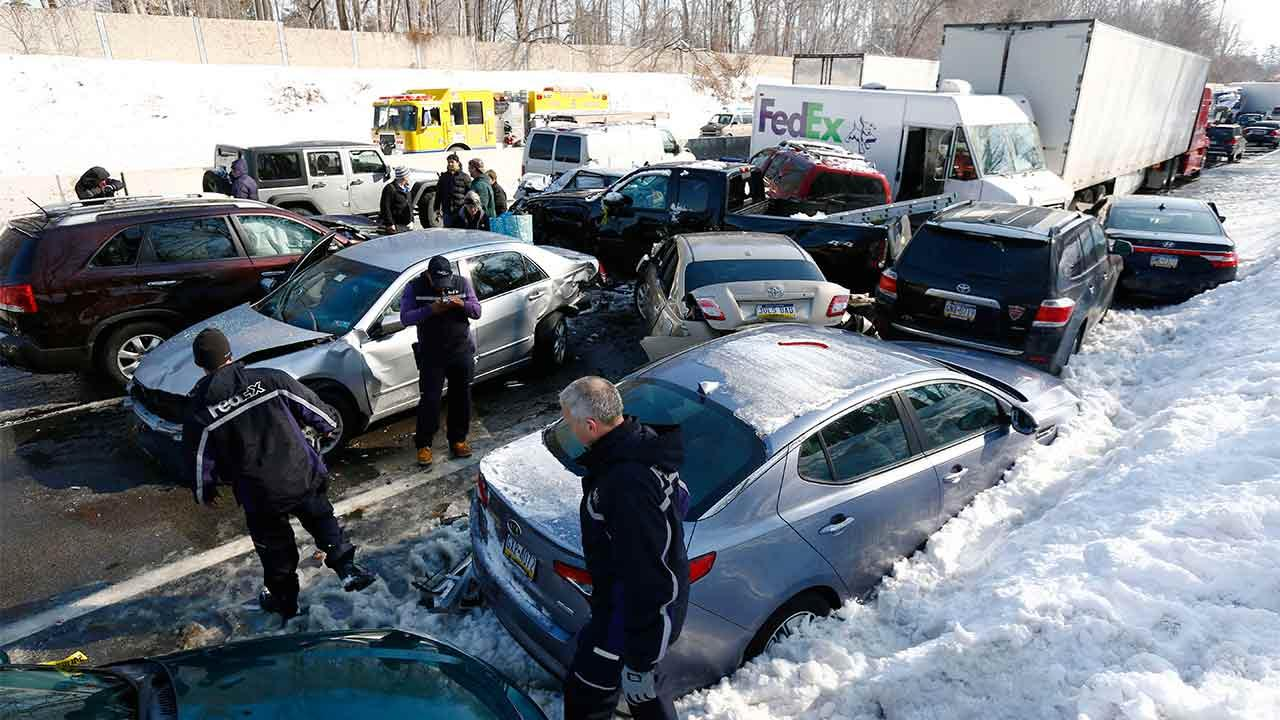 Vehicles are piled up in an accident, Friday, Feb. 14, 2014, in Bensalem, Pa. Traffic accidents involving multiple tractor trailers and dozens of cars have completely blocked one side of the Pennsylvania Turnpike outside Philadelphia and caused some injuries.Matt Rourke/AP