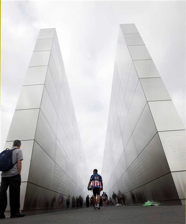 A rider from the Ride 2 Recovery 9&#47;11 Challenge walks through the Empty Sky memorial in Liberty State Park Sunday Sept. 11, 2011 in Jersey City, N.J. From Liberty State Park the ride will go to the United 93 Memorial in Shanksville, Pa., and then on to the Pentagon in Washington DC, a total of 530 miles in 8 days.  <span class=meta>(&#40;AP Photo&#47;Joe Epstein&#41;)</span>