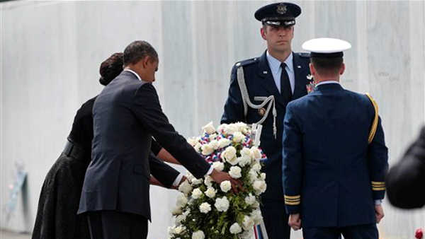 President Barack Obama and first lady Michelle Obama place a wreath at the Flight 93 National Memorial Sunday, Sept., 11, 2011, in Shanksville, Pa., on the 10th anniversary of the Sept. 11 attacks. <span class=meta>( &#40;AP Photo&#47;Pablo Martinez Monsivais&#41;)</span>