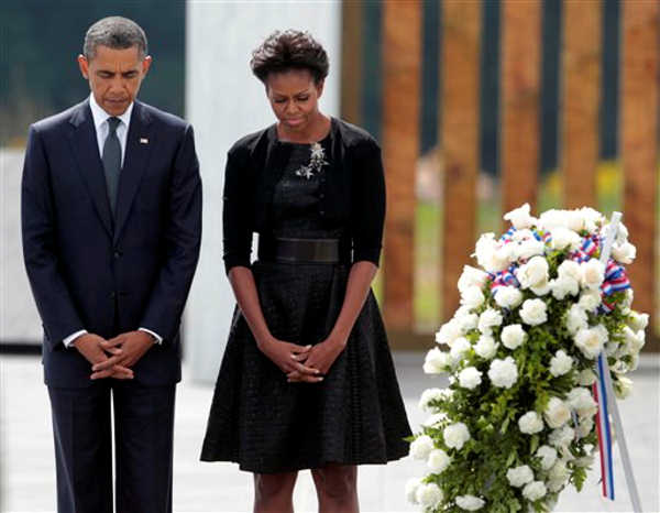 President Barack Obama and first lady Michelle Obama pause for a moment of silence at the wreath laying ceremony at the Flight 93 National Memorial Sunday, Sept., 11, 2011 in Shanksville, Pa., on the 10th anniversary of the Sept. 11 attacks. <span class=meta>(&#40;AP Photo&#47;Pablo Martinez Monsivais&#41;)</span>