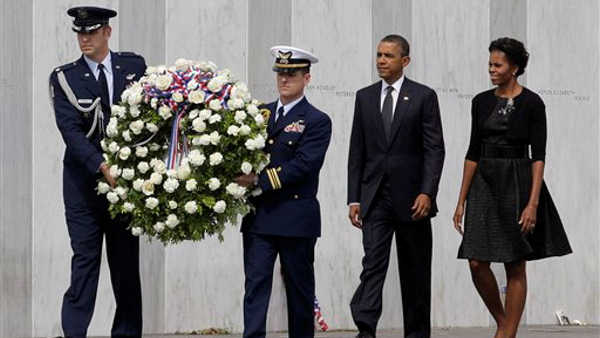 President Barack Obama and first lady Michelle Obama lay a wreath at the Wall of Names at phase 1 of the permanent Flight 93 National Memorial near the crash site of Flight 93 in Shanksville, Pa. Sunday Sept. 11, 2011, on the 10th anniversary of the Sept. 11 attacks.  <span class=meta>(&#40;AP Photo&#47;Amy Sancetta&#41;)</span>