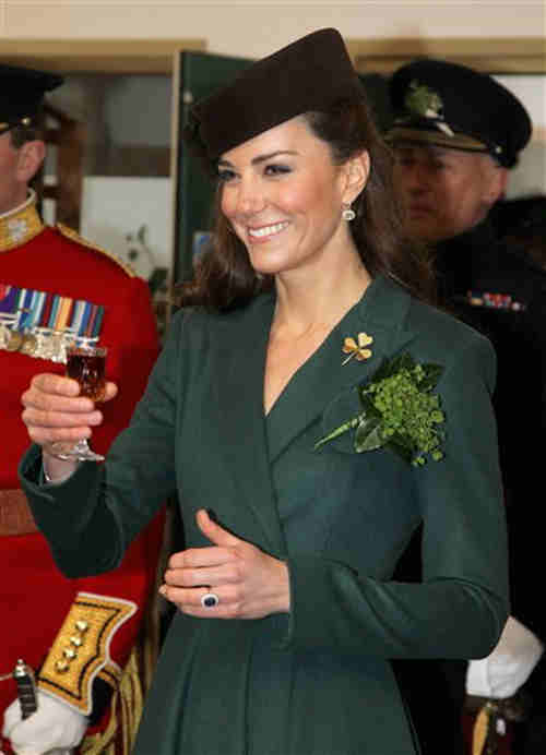 The Duchess of Cambridge holds a glass of Harvey's Bristol Creme in the Junior's Mess as she visits Aldershot Barracks on St Patrick's Day on Saturday March 17, 2012 in Aldershot, England. The Duchess presented shamrocks to the Irish Guards at a St Patrick's Day parade during her visit. (AP Photo/Chris Jackson, Pool)