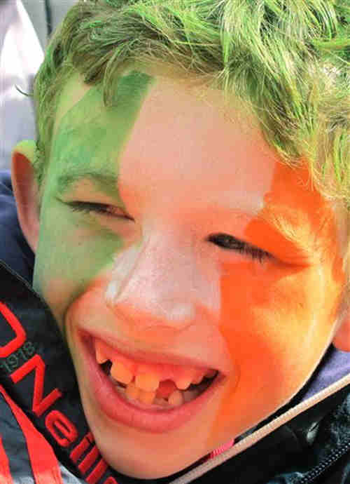 Jack Murphy, aged 7, has his face painted in the green, white and orange, the colours of Ireland's flag at St. Patrick's Day parade in Dublin, Saturday, March 17, 2012. Police estimate a half-million spectators lined the route of the parade, the biggest of more than 50 across Ireland to celebrate the nation's patron saint. (AP Photo/Shawn Pogatchnik)